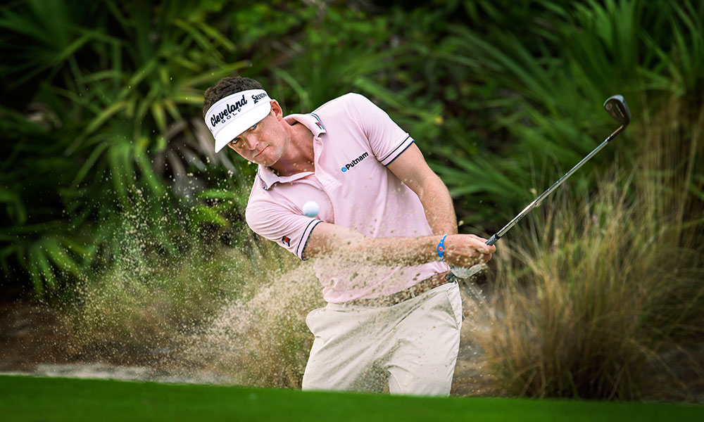 Keegan Bradley hits it out of a sand trap